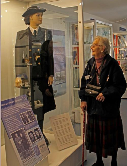 Former Petty Officer Wendy Hogarth inspects the uniform she wore when serving at Defford in 1945. Photo: Katheryn Rudd